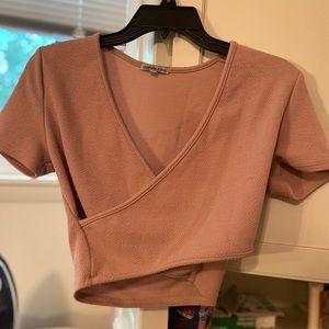 a creme cropped shirt